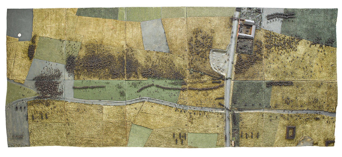 A patchwork of fields showing a moment in the battle of Waterloo