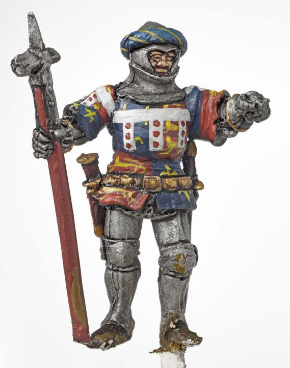 Miniature model of a solider in red, white and blue holding a lance.