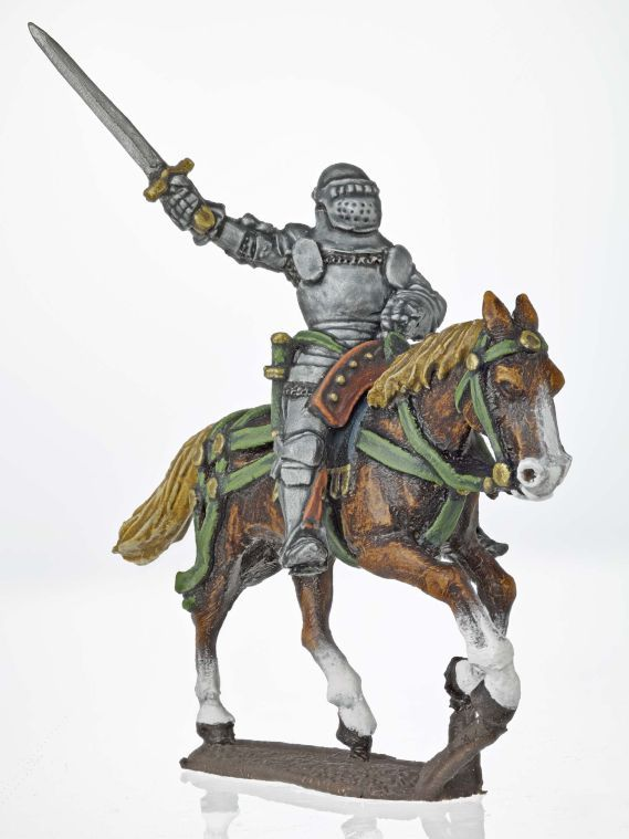 Miniature model of a soldier on horseback holding a sword about his head