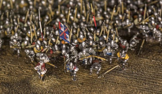 Close up of miniature model soldiers charging into battle