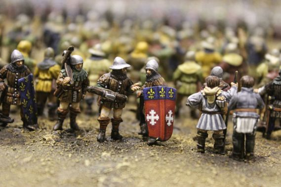 close up of miniature model soldiers stood in a row