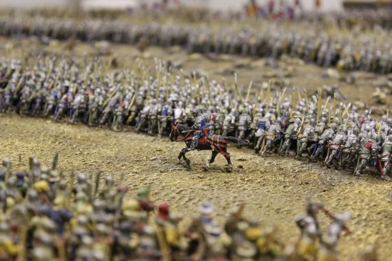 Miniature model of a soldier on a horse surrounded by soldiers