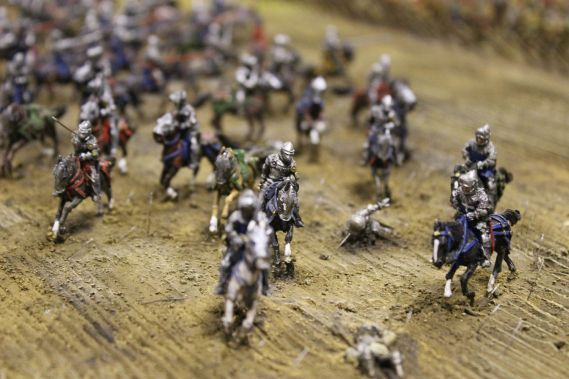 close up showing miniature models of horses and soldiers in battle