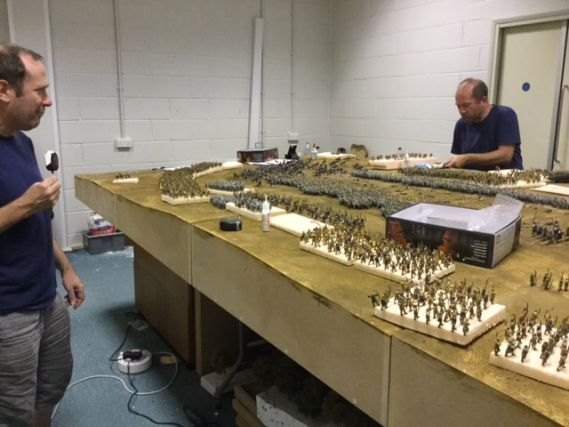 two men working on a miniature model