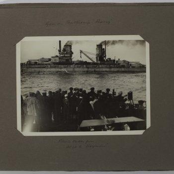 crowd watching ships at sea