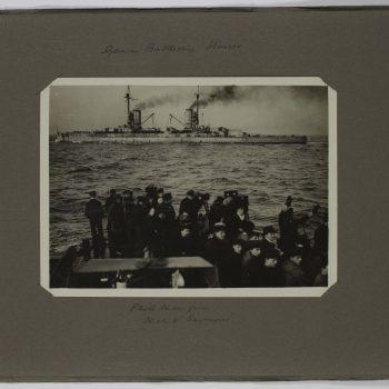 crowd looking at battleships