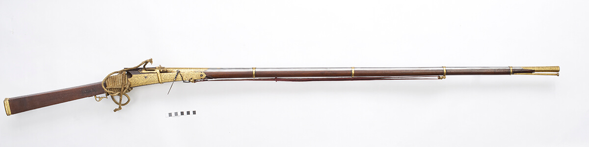 Long barrelled gold decorated matchlock musket