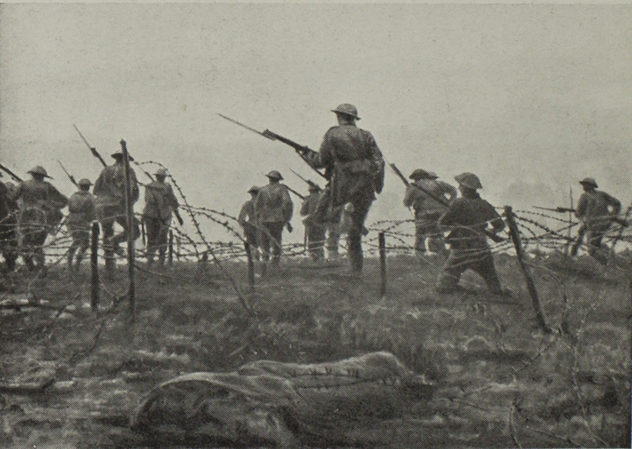 Soldiers advance through barbed wire