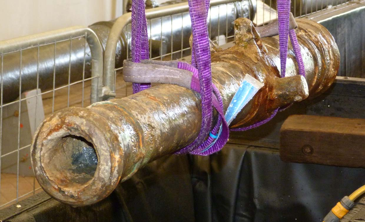 Corroded cannon being prepared for conservation