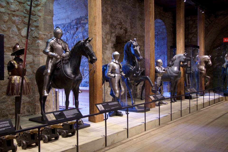 A row of armours and horses in the Tower of London