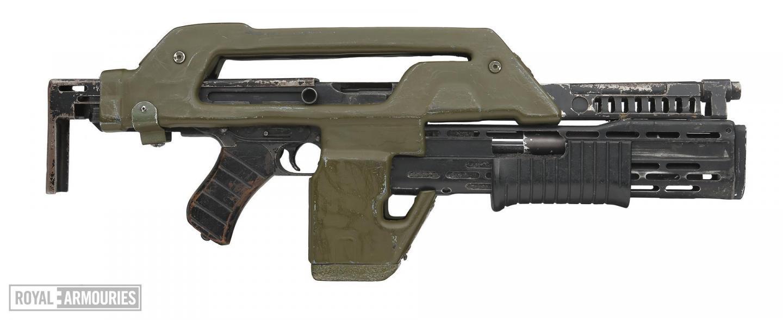 Green plastic metal gun