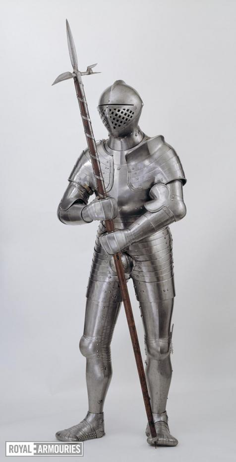 Steel armour covering entire body holding a pollaxe