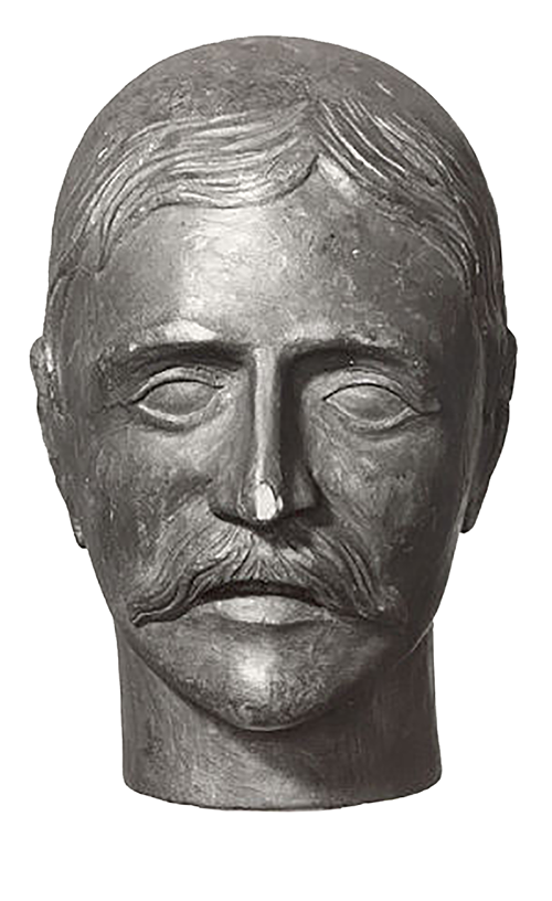 Carved wooden head of man with moustache