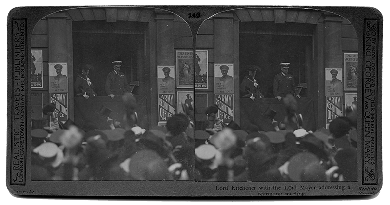 A crowd of people watching an address by Lord Kitchener