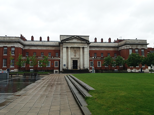 Large red brick building with white marble classical portico