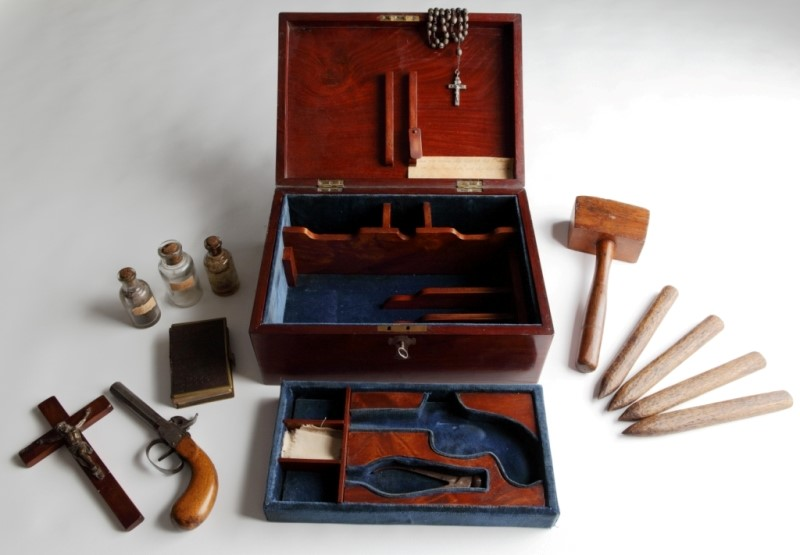 mahogany box filled with weapons and religious items