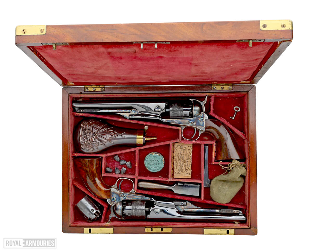 Two revolvers in a red presentation case