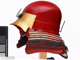 red helmet with fabric decoration