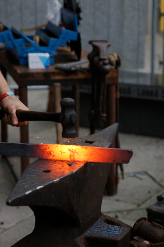 A red hot bar on the anvil on its way to becoming a sword