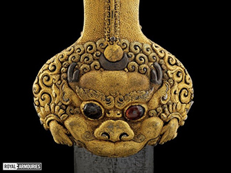 ornate gold sword pommel