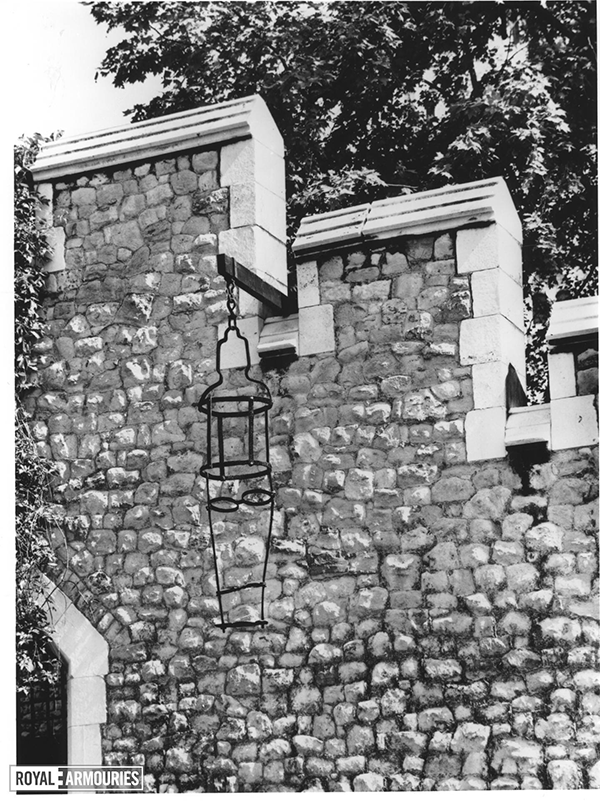 Gibbet hanging off a stone wall