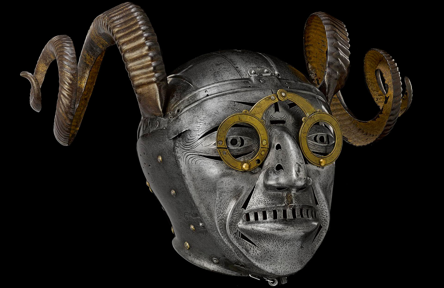 skull shaped helmet with iron rams horns and wearing a pair of brass spectacles.