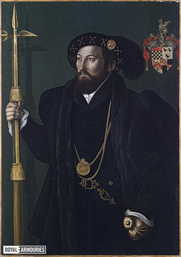 A Tudor man with a beard, wearing gold chains, a hat and carrying a pollaxe