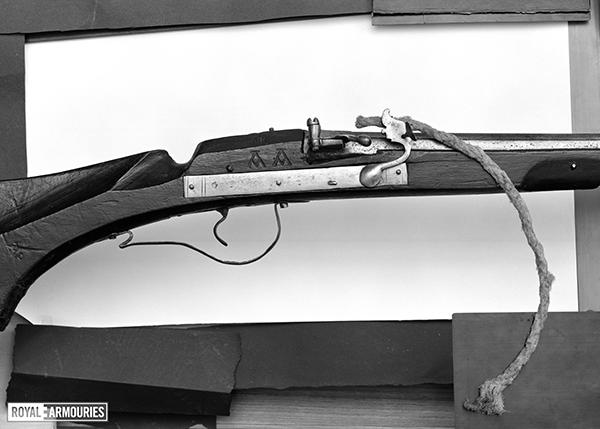 Side view of a matchlock gun