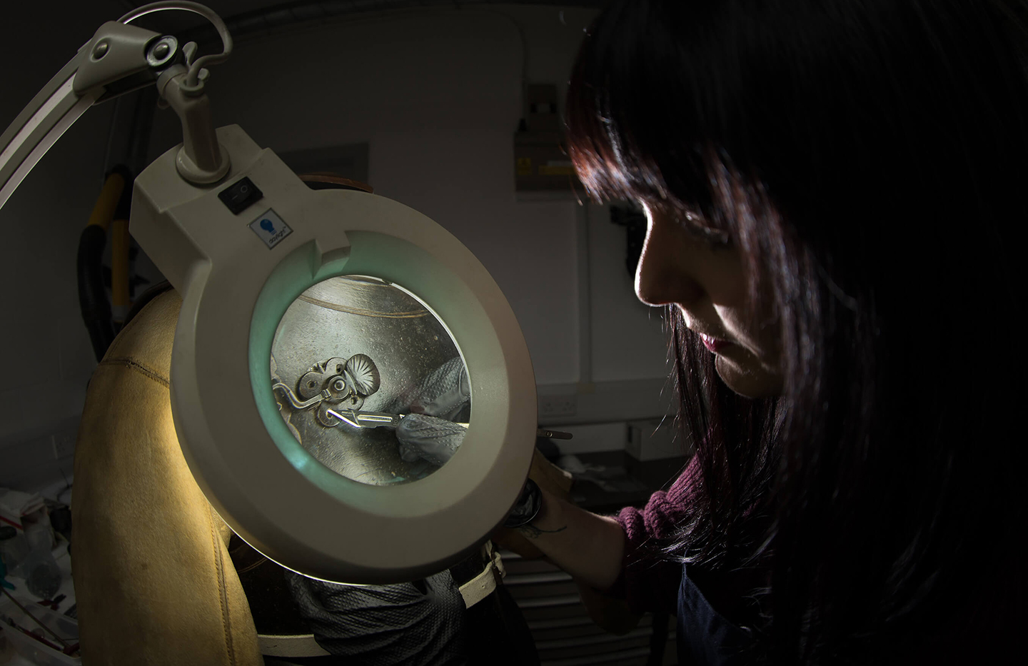 Conservator examining an object