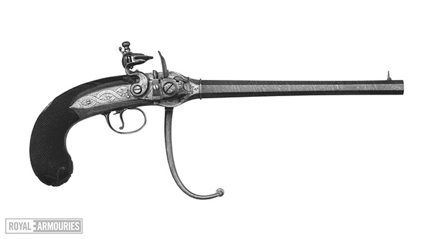 black and white image of a flintlock pistol