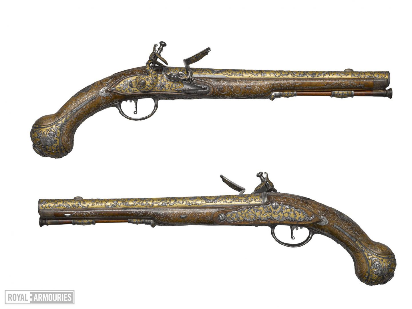 A pair of highly decorated gold sporting pistols