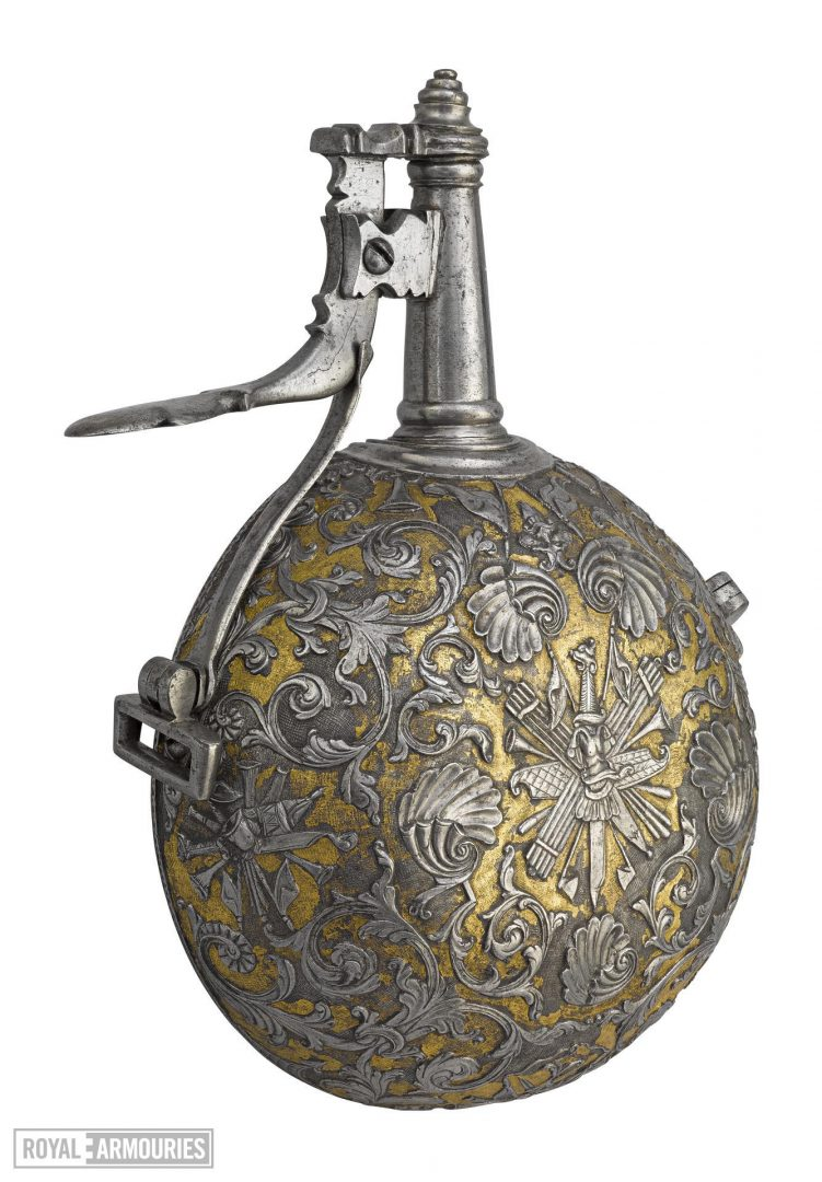 A round powder flask highly decorated in silver an gold