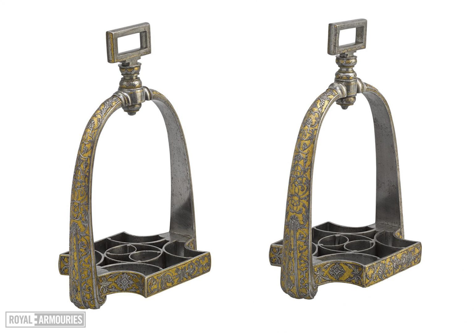 A pair of stirrups highly decorated in gold and silver