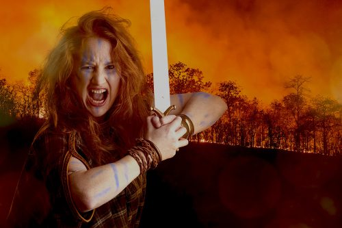 Flame haired warrior woman Boudicca lets out a battle cry