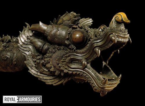 A bronze cannon's muzzle in the form of a dragon's head