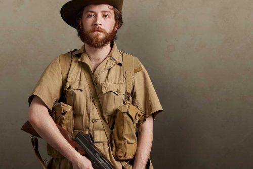 A Second World War British Chindit soldier in jungle battle dress holding a Thompson M1A1 machine gun