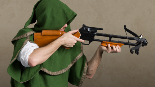 Man in green hood holding a crossbow