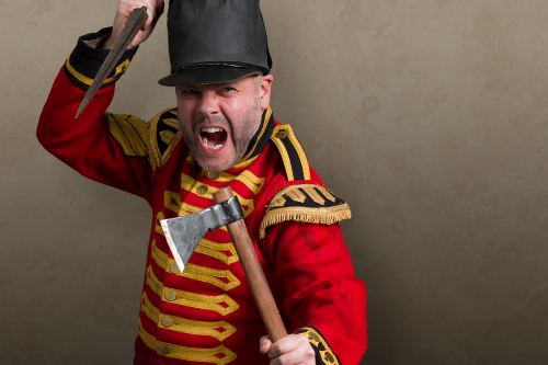 man in red uniform with gold braid, holding dagger and axe