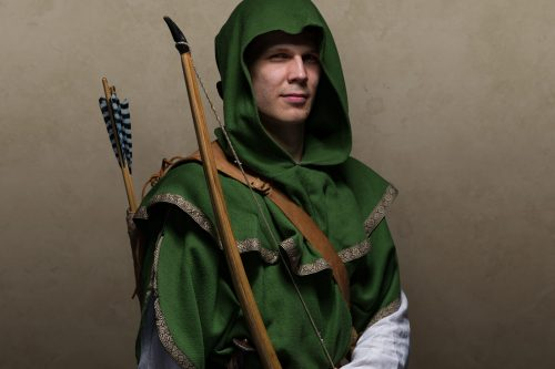 a hooded archer in green