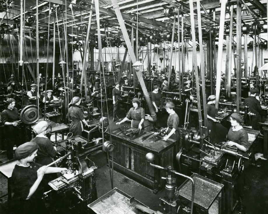 Black and white wide photograph of women working in a factory
