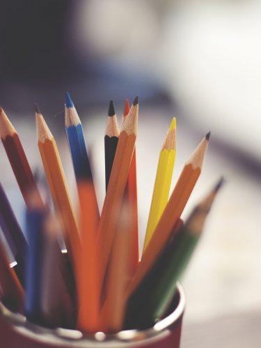 a jar of coloured pencils
