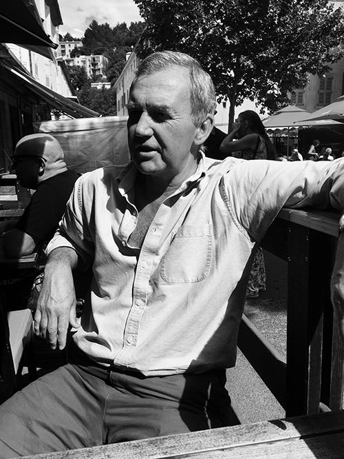 man in white shirt sat relaxing