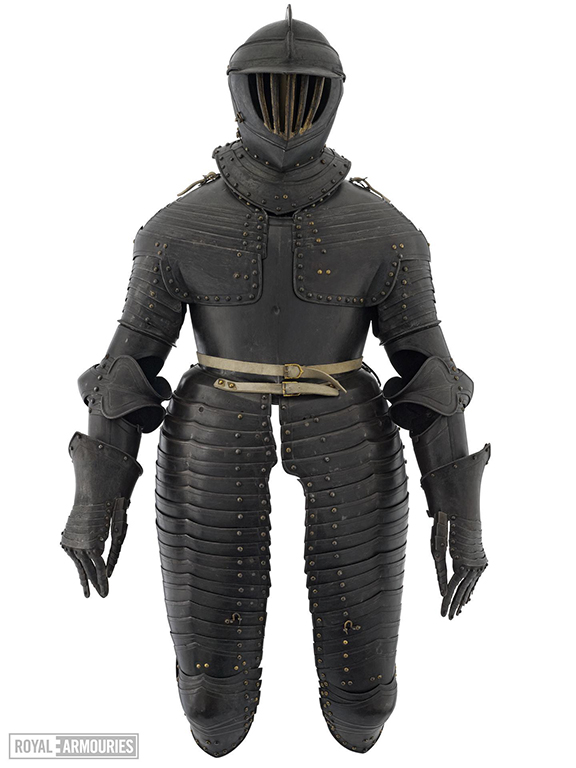 photograph of dark metal plated three-quarter armour covering the whole body to the knees, complete with close helmet, shoulders, breastplate, legs with tassets and gauntlets