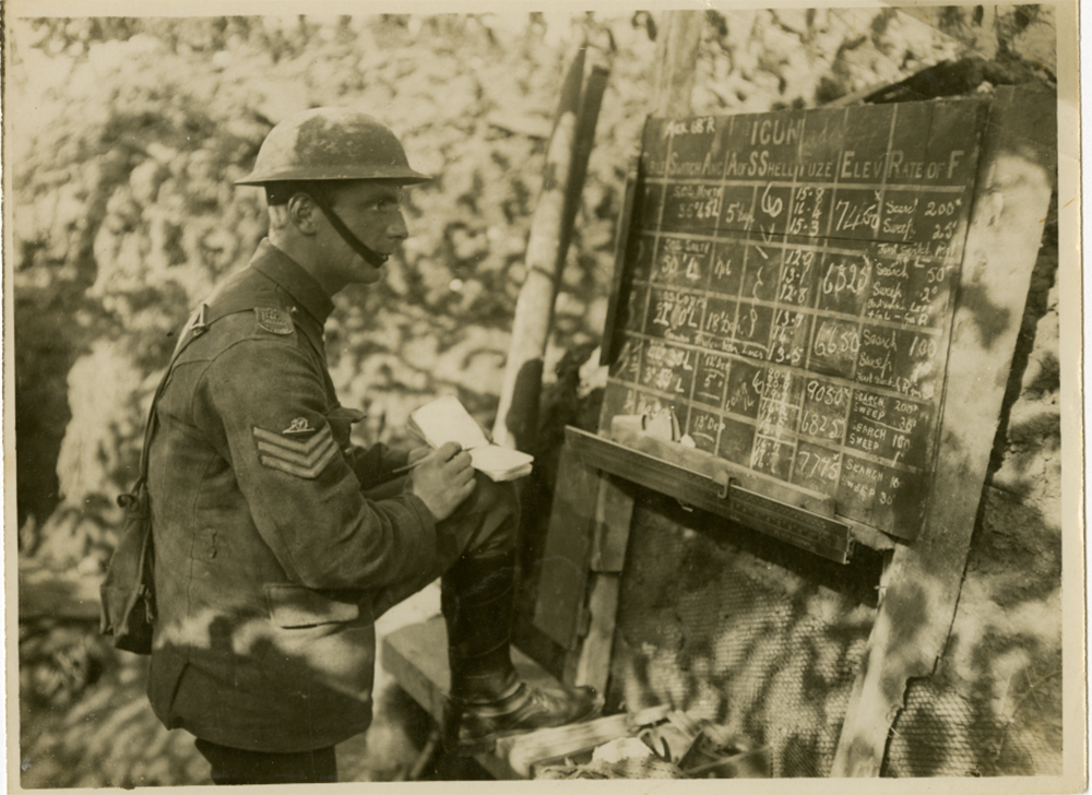 Archive photograph of soldier sat in front of a chalkboard taking notes