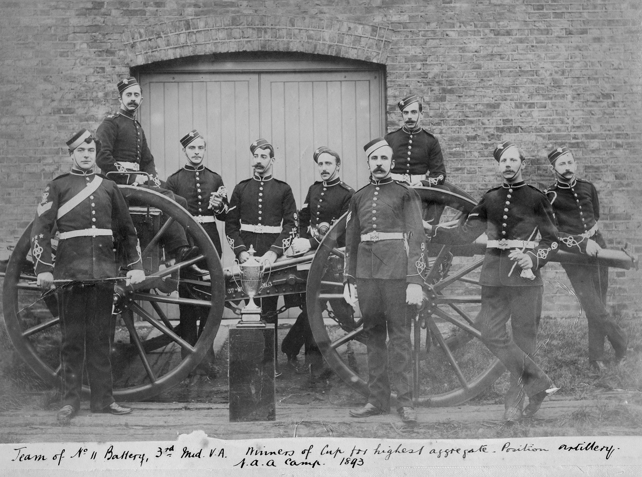 Victorian Royal Artillery soldiers posing with their gun, carriage and trophy