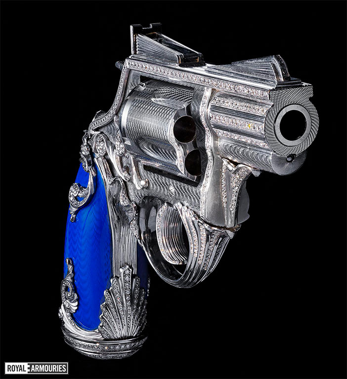 Revolver with blue enamelled grips decorated with diamonds