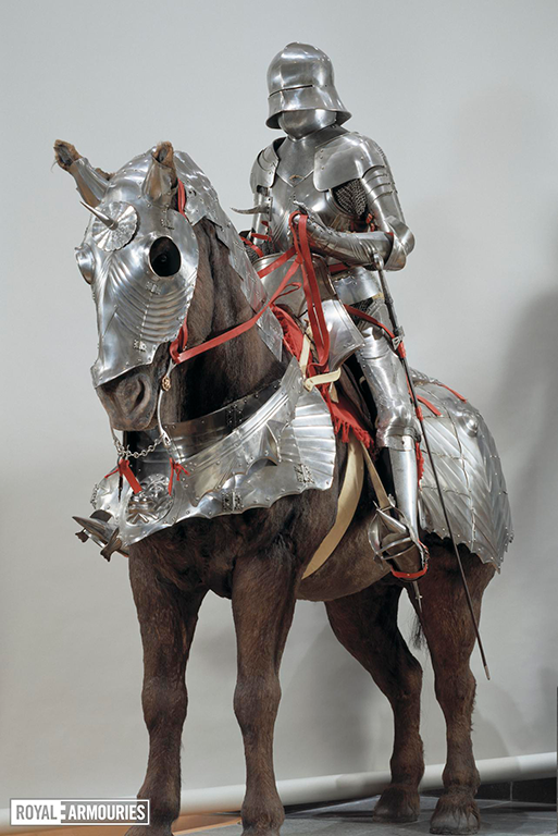Man in composite silver armour, mounted on horse