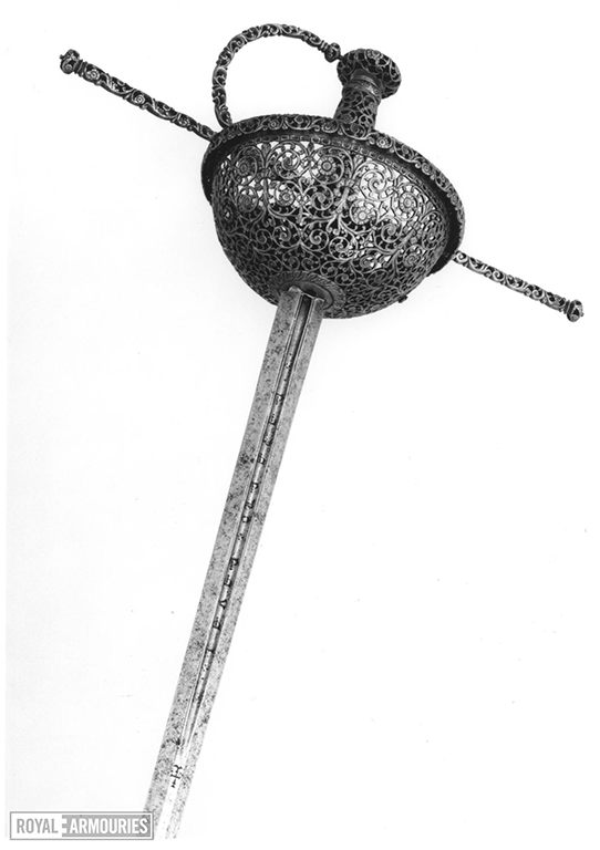 Close up of hilted rapier, with straight quillons, entirely pierced and engraved with arabesques, the blade grooved and inscribed 'Pedro-del-Monte, en Toledo