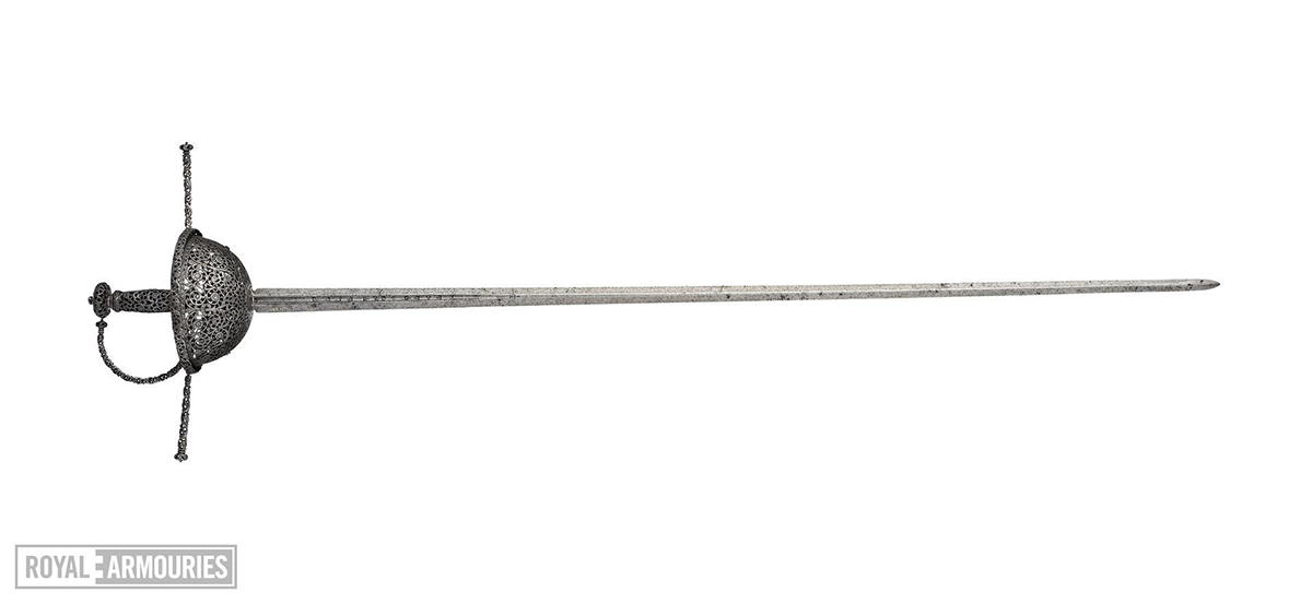 Wide shot of a rapier, decorated with fine scroll and foliate work