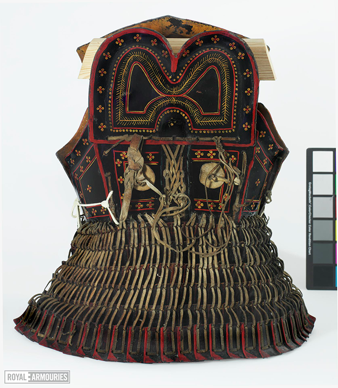 Leather cuirass, of laced leather panels, and a lamellar skirt. The plates are of leather, lacquered black on the outside with decoration in red and yellow.